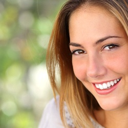 woman smiling outside