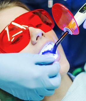 Woman receiving dental bonding treatmetn