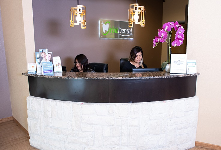 Two team members behind reception desk
