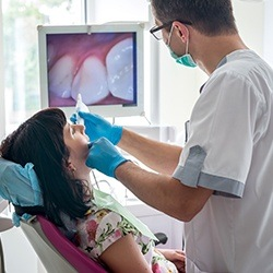 Dentist and patient looking at intraoral images