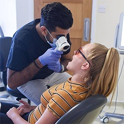 Dentist performing caviting screening