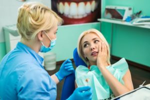 a female patient seeking help with a dental emergency